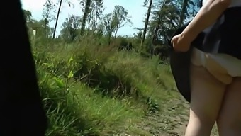 Upskirt bum in the wood substrates Part One.mp4