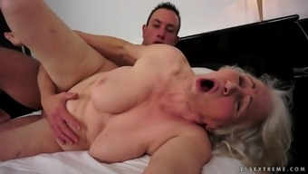 Affectionate grown granny squealing while being cracked doggystyle