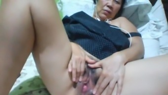 Filipino granny 58 fucking me stupid on cam. (Camel)1(one)