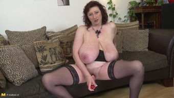 Tremendously busty Dutch redheaded friction her grow older pussy