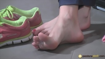 In workout a toddler lifts off her trainers and indicates her ft