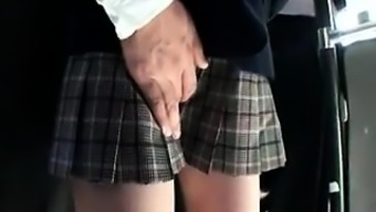 Adorable Oriental schoolgirl possesses a perverted guy endearing her puss
