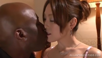 Japanese hussy gets her pussy stroked and torn using a black dude