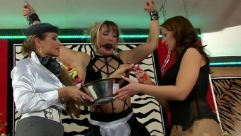 Femdom lesbian threesome by using chained blond