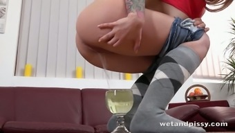 Whorish girl Catharine Beaches is pissing and masturbating her gaped pussy