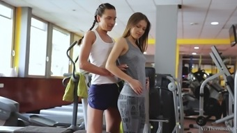 Evil lesbian girls overcome one another in the gym