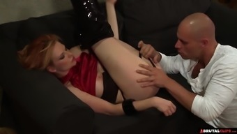 Wild redhead MILF Tarra White takes off her leather pants and fucks