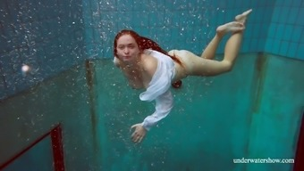 Marvelous looking busty girl Lola swims int he most arousing type