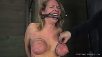 Busty blond with the use of tattoos is having a hard time inside the prison