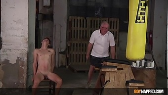 Tied up gay dude likes it when two guys spank his butt together