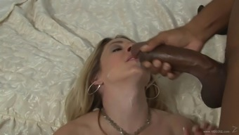 This lively light colored cougar is hooked on large dark colored penis