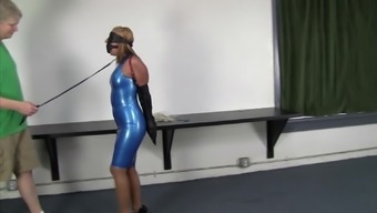 Desk Within the Ivory Latex Outfit Collared Leashed And Skilled