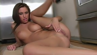 Attractive cherub gives a spa solo with her the kitchen