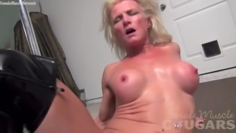 Strong cougar Mandy Foxx is masturbating in sexy boots