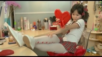 Asian schoolgirl toys her tight pussy